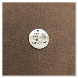 "Médaille ronde ""you are my sunshine"" - gravure au choix"
